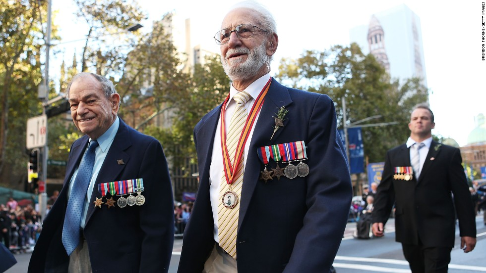 War veterans walk down George Street during the ANZAC Day parade on Thursday in Sydney, Australia.