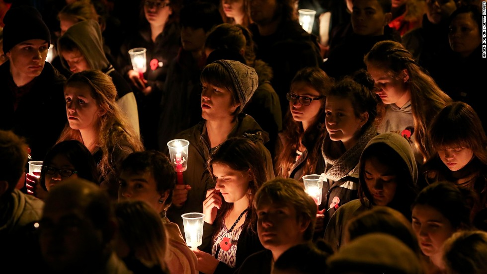Members of the public hold candles during the dawn service at the Wellington Cenotaph on Thursday in Wellington, New Zealand.