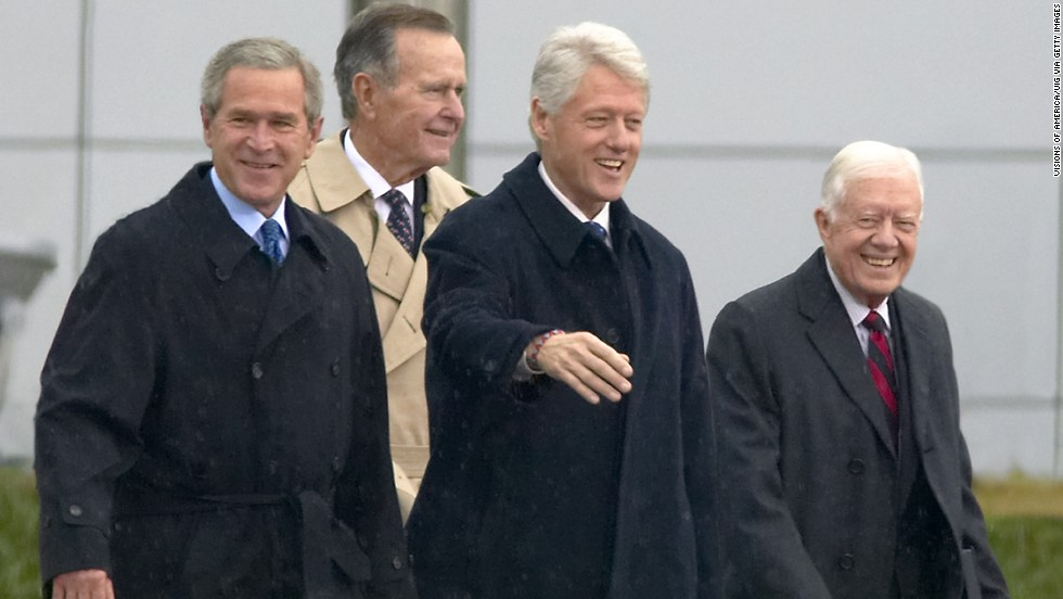 George W. Bush, George H. W. Bush, Bill Clinton and Jimmy Carter appeared together during the opening ceremony of the Clinton Presidential Library on November 18, 2004, in Little Rock, Arkansas.