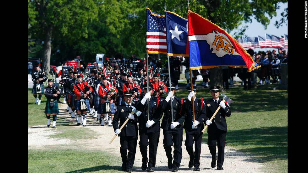 "Firefighters lead the funeral procession for Capt. Kenneth ""Luckey"" Harris Jr. on Thursday, April 24, in West, Texas."