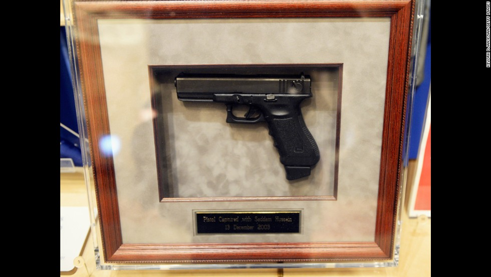A pistol captured with Saddam Hussein on December, 13, 2003, is displayed at the Center.