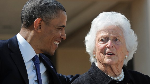 President Obama speaks with former first lady Barbara Bush during the ceremony.