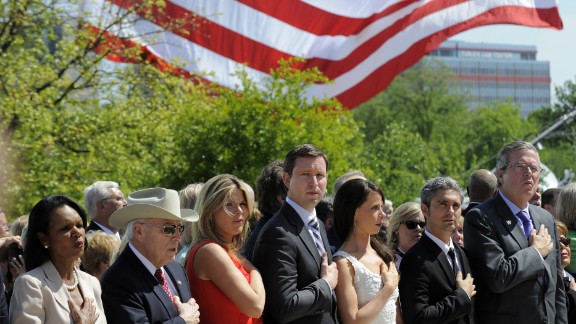 Left to right: former Secretary of State Condoleezza Rice, former Vice President Dick Cheney, Jenna Bush Hager, her husband Henry Hager, Barbara Bush, Miky Febrega,  and former Florida Gov. Jeb Bush sing the national anthem at the ceremony.