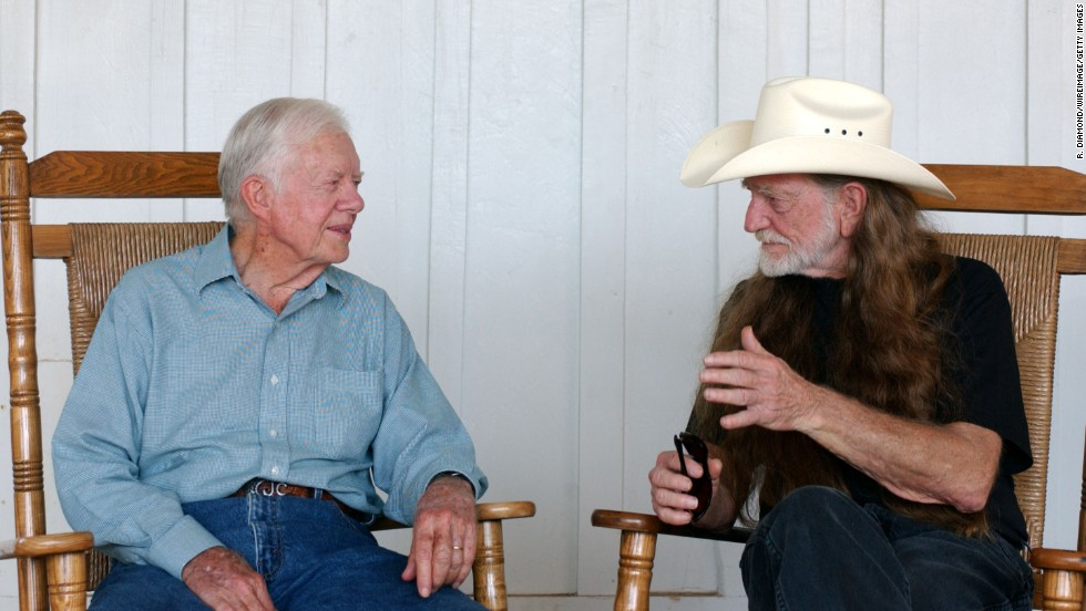 "Former President Jimmy Carter and Nelson talk at the taping of ""CMT Homecoming: Jimmy Carter in Plains,"" in December 2004."