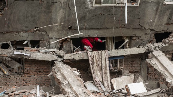 Rescuers check a collapsed building in Lingguan township in Ya