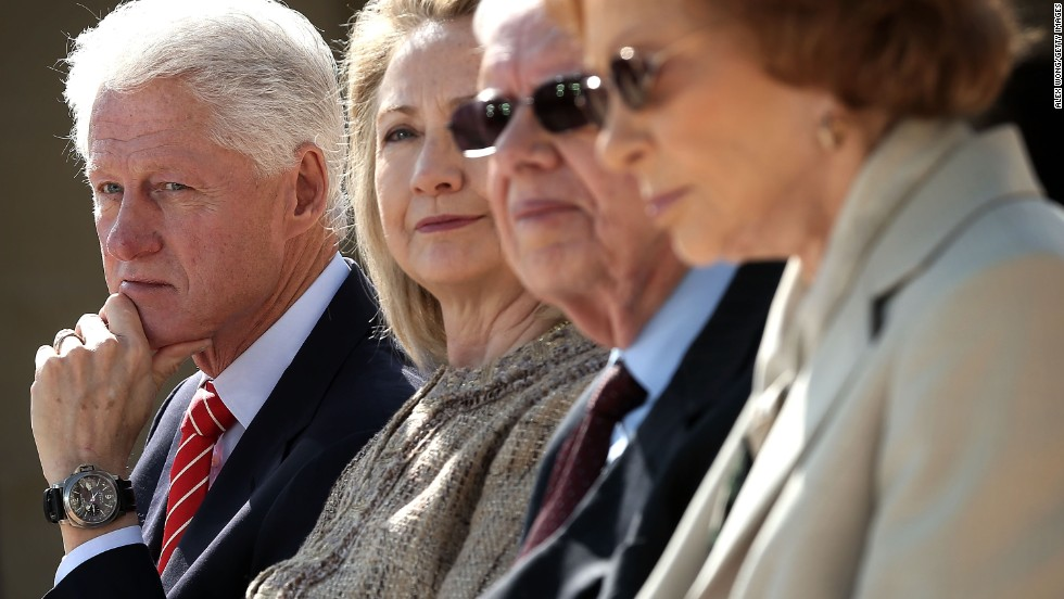 Left to right: Former President Bill Clinton, former first lady Hillary Clinton, former President Jimmy Carter and former first lady Rosalynn Carter listen during the opening ceremony.