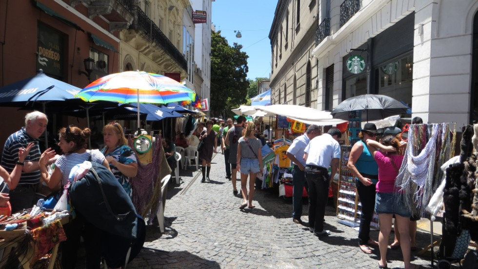 A Sunday market in Buenos Aires. The city has many cafes, and the culture is such that people take time to sit down for coffee, says psychologist Albert Brok. Starbucks has also made its way there.