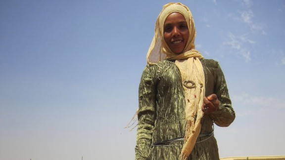 """He describes the way women in Darfur dress as """"colorful, unique, proud and fashionable."""""""