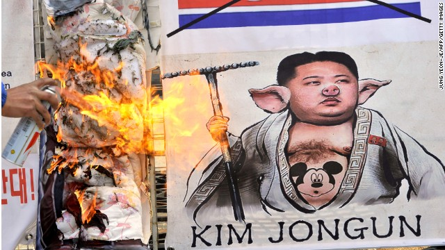 A South Korean burns a caricature of North Korean leader Kim Jong Un at a rally in Seoul on April 18.