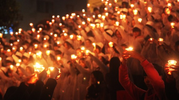 Students of the University of South China light candles to pray for quake victims on April 24 in Hengnan, China.