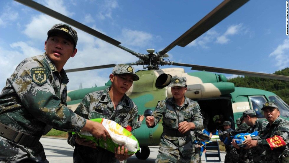 Rescuers load relief supplies onto a helicopter in Ya'an on April 24.