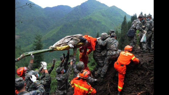Rescuers carry a victim