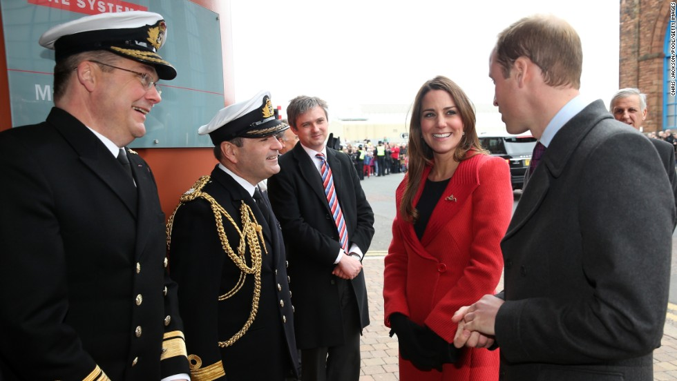 Rear Adm. Simon Robert Lister and Cmdr. Steve Garrett greet Catherine and her husband, Prince William, as they visit the Astute-class Submarine Building on April 5.