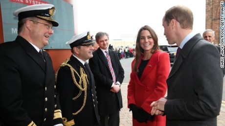 BARROW-IN-FURNESS, UNITED KINGDOM - APRIL 05:  Prince William, Earl of Strahearn and Catherine, Countess of Strathearn are greeted by Rear-Admiral Simon Robert Lister and Commander Steve Garrett as they visit the Astute-class Submarine Building at BAE Systems on April 5, 2013 in Barrow-in-Furness, United Kingdom. The Duke of Cambridge is Commodore-in-Chief of the Royal Navy Submarine Service and during their visit they will tour the offices of Vanguard replacement programme and meet with the crew of Artful and their families, who are now based in Barrow.  (Photo by Chris Jackson-Pool/Getty Images)
