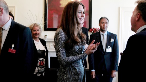 On her first public engagement since early January, the Duchess talks with the trustee at Hope House residential center, run by Action on Addiction for recovering addicts, on February 19 in London.