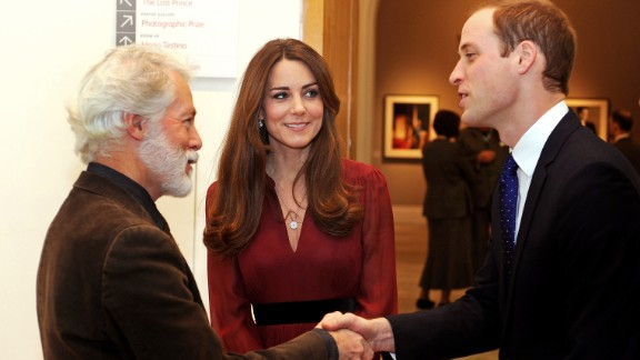 """Prince William shakes hands with artist Paul Emsley as Catherine looks on after viewing his <a href=""""http://www.cnn.com/2013/01/11/world/europe/duchess-of-cambridge-first-portrait"""">new portrait of the Duchess</a> during a private viewing at the National Portrait Gallery on January 11."""