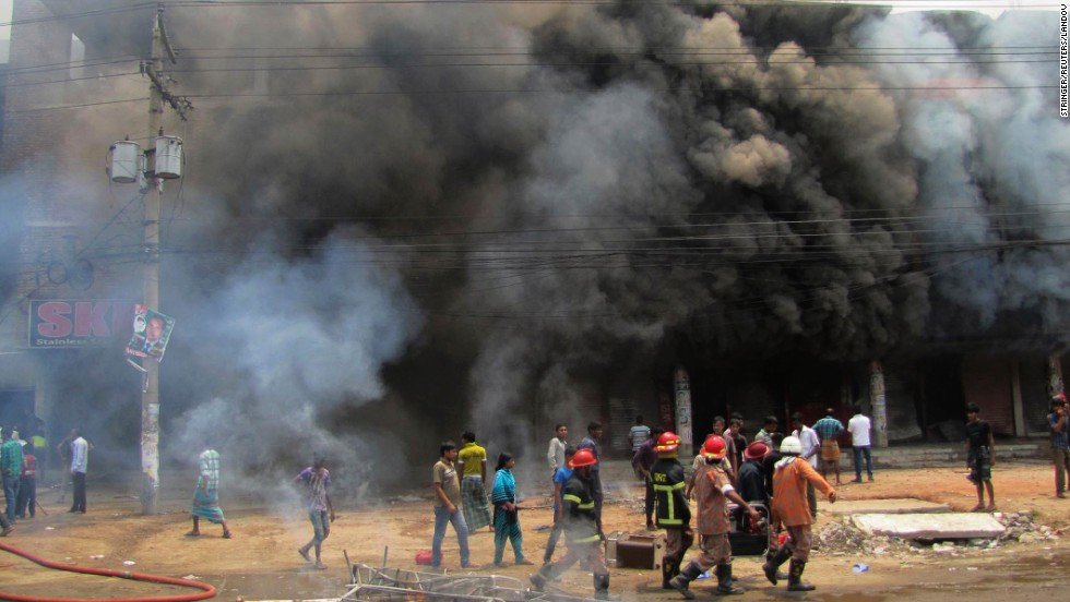Firefighters work after protesters set fire to a spinning mill in Gazipur.