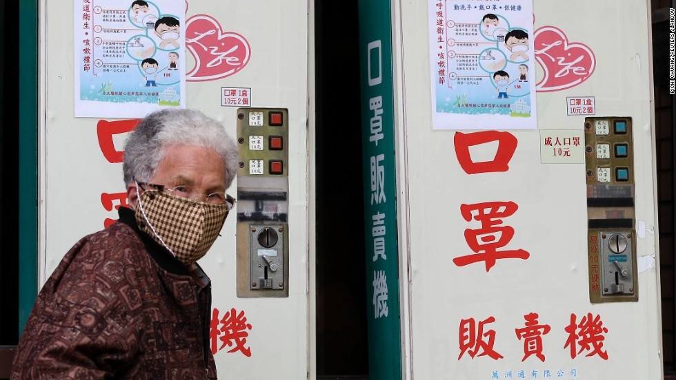 A woman wearing a medical mask walks past vending machines that sell masks outside National Taiwan University Hospital in Taipei on April 26. A 53-year-old Taiwanese businessman has contracted the H7N9 strain of bird flu while traveling in China, Taiwan's Health Department said on April 24. It's the first reported case outside of mainland China. The man was hospitalized after becoming ill three days after returning from Suzhou on April 9.