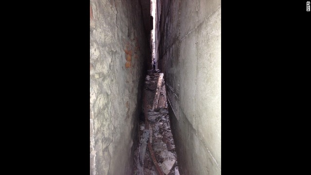 Part of a landing gear was discovered wedged between 51 Park Place and another building.