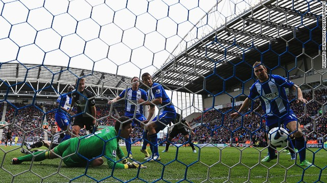 Wigan's Emmerson Boyce (2nd left) concedes an own goal against Tottenham Hotspur at the DW Stadium.