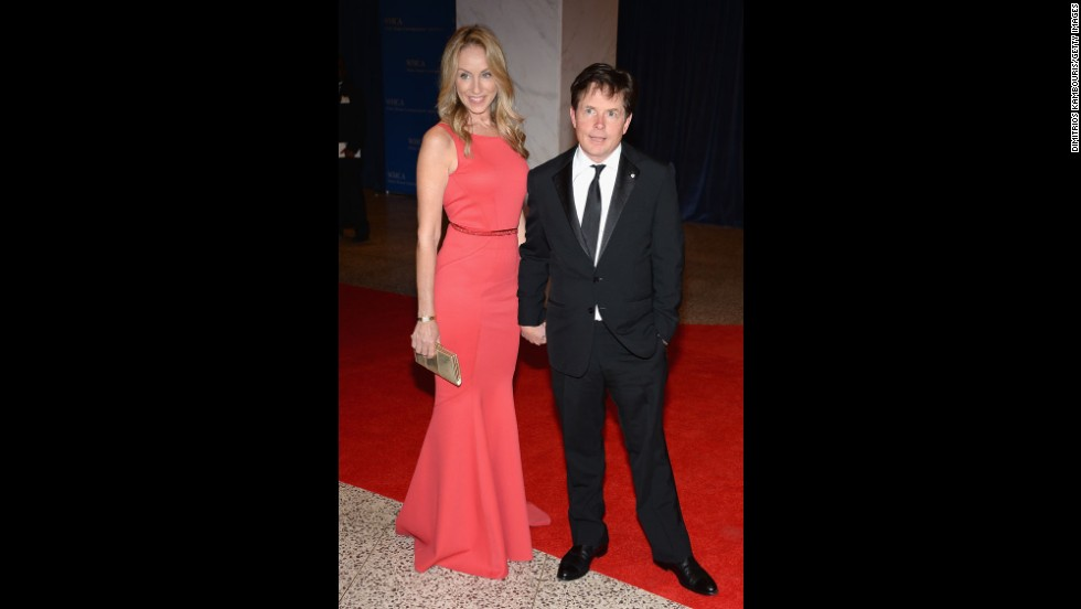 Tracy Pollan and husband Michael J. Fox pause on the red carpet for a photograph.