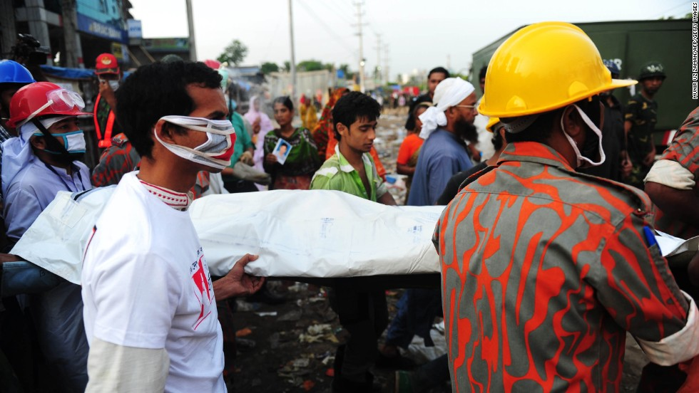 Rescue workers carry a victim's body recovered from the rubble on April 28.