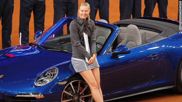 Maria Sharapova poses next to the Porsche 911 Carrera which she claimed by winning the WTA tournament in Stuttgart.