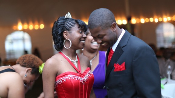 Mareshia Rucker, one of the 2013 prom organizers, wore a long, red gown and a small tiara in her hair. Her date, Mercer University student Arkel Bennett, wore a matching vest and tie. Mareshia