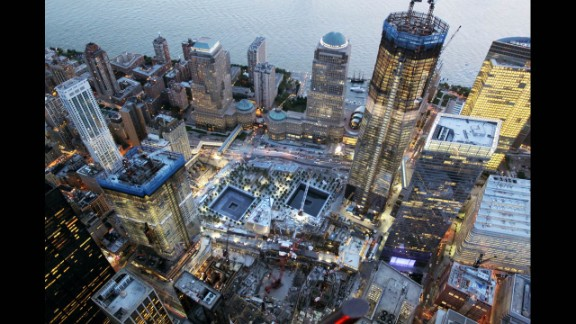 Construction continues on One World Trade Center on August 12, 2011, beside the memorial footprints of the twin towers.