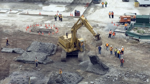 An excavator moves protective mats into position over the hole where test blasts were fired in preparation for the footings of what was then called Freedom Tower on June 12, 2006.