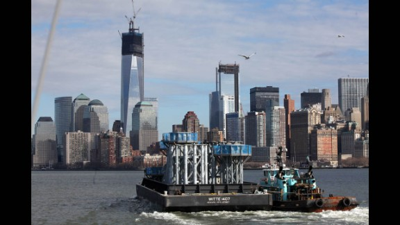 Parts of the spire for the new skyscraper make their way on a barge from Port Newark to Lower Manhattan on December 11.