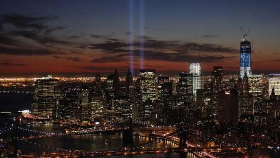 """The """"Tribute in Light"""" shines near the spots where the twin towers once stood as red, white and blue light up the new building on the 11th anniversary of the attacks."""