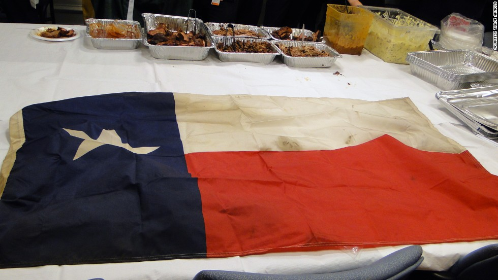 Arnold gave this Texas flag, which he retired from his mobile smoker, to Kabrhel.