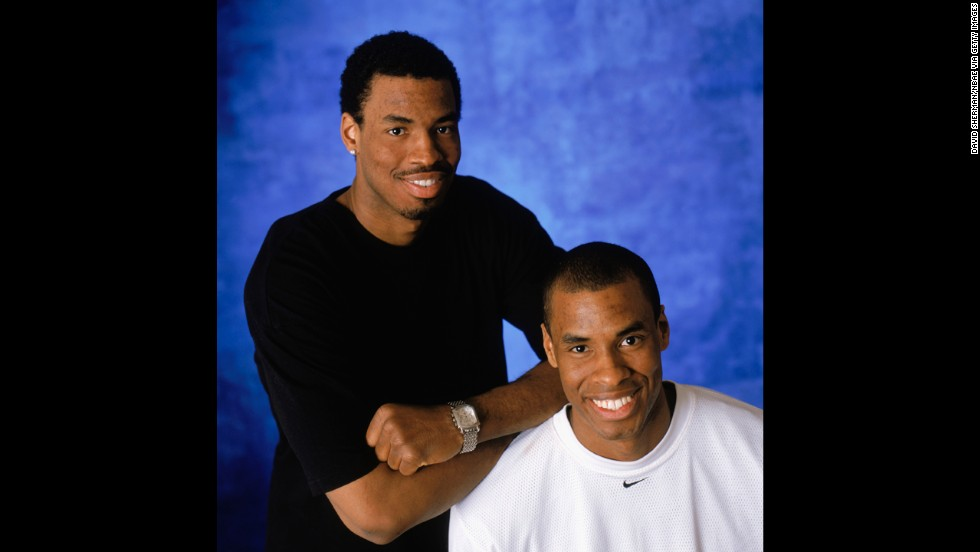 Collins and his twin brother, Jarron, pose for a portrait during the 2004 NBA All-Star Weekend.