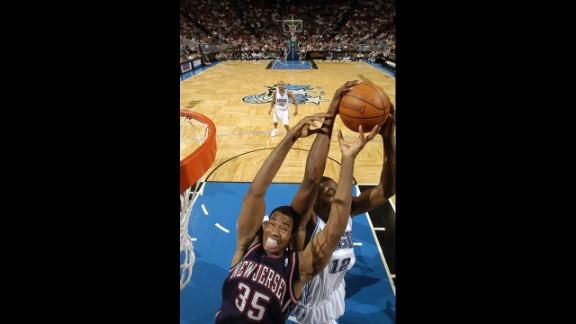 Dwight Howard of the Orlando Magic steals the ball from the Nets