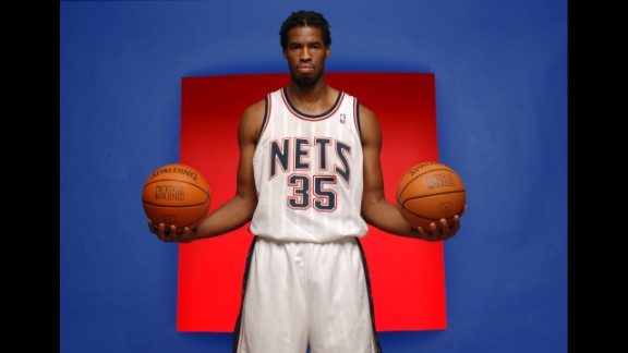 Collins poses for a portrait during Nets Media Day in 2005 at the team