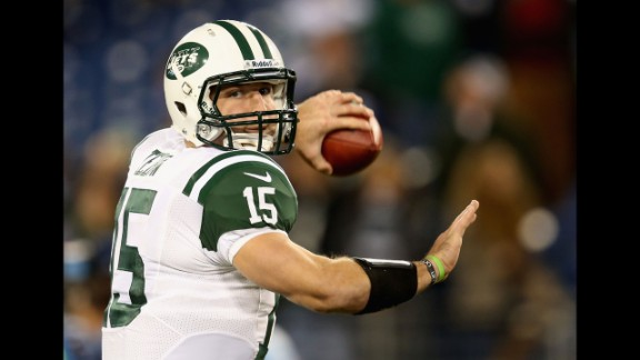 Tebow warms up before the Jets