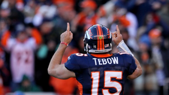 Tebow celebrates after running for a touchdown during the Broncos
