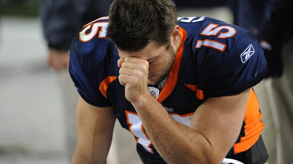"Tebow prays during the final minute of a game in November 2011. The pose, which often came after touchdowns, came to be known as ""Tebowing."""