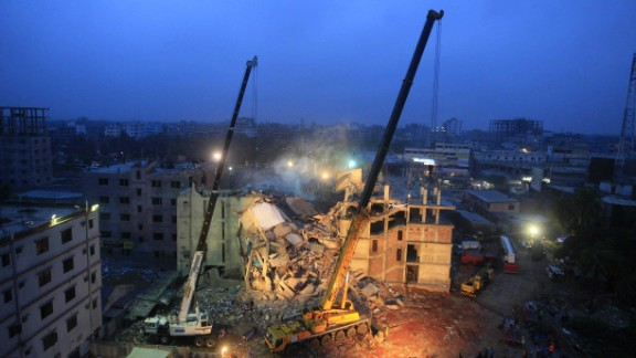 Cranes operated by Bangladeshi army personnel work on Monday, April 29.