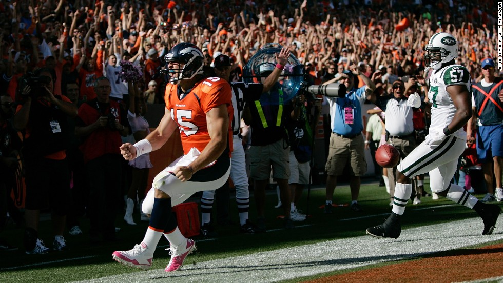 Tebow celebrates his first NFL touchdown run in October 2010.