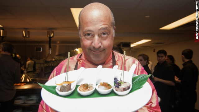 Zimmern prepares food for guests at the SUS fundraising dinner