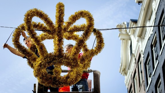A crown is hung in the center of Amsterdam on April 23, 2013 ahead of Beatrix's abdication.
