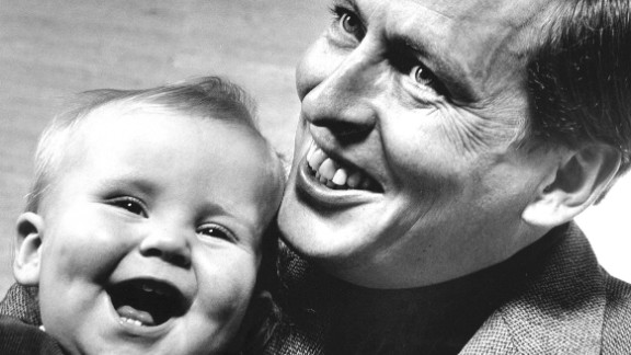 Prince Claus holds his son Willem-Alexander in 1968.