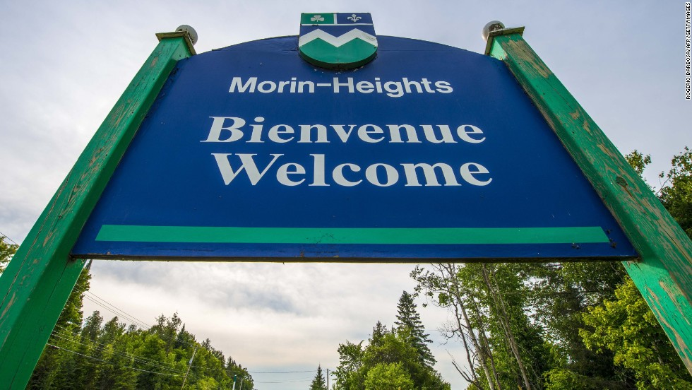 "A sign reading ""Welcome"" in French and English stands at the entrance to Morin-Heights, a tourist town in the Laurentian Mountains region of Quebec, Canada. In Quebec, French must be the predominant language on signs. For more on the province read Erik Leijon's <a href=""http://www.cnn.com/2013/05/01/travel/quebec-11-things/index.html"">11 things to know before visiting Quebec</a>."