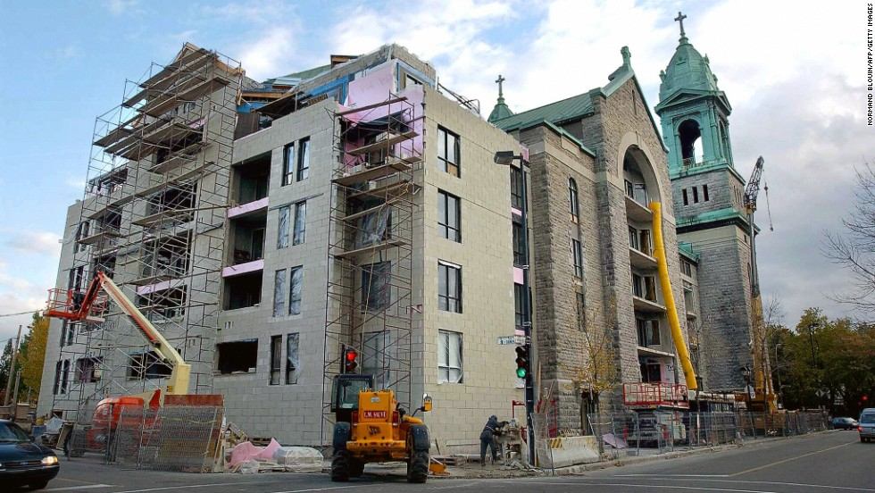 The Saint-Jean de la Croix church in Montreal, Quebec, undergoes major renovations in 2003 after being sold to be converted into condos. Many such buildings are for sale, and buyers have been difficult to come by. Some are being demolished, while others have been converted for nonreligious purposes.