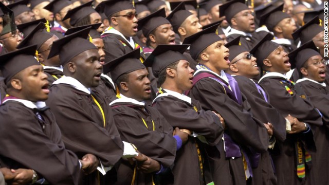 Members of the Morehouse College 2002 graduating class sing their school song during commencement ceremonies May 19, 2002 in Atlanta. About 500 men received their undergraduate degrees from the predominately black school.