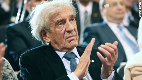 Elie Wiesel claps as President Barack Obama speaks at the Holocaust Museum in 2012 in Washington.