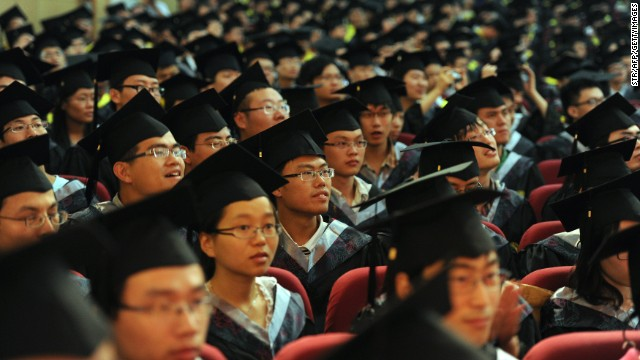File image from 2012 shows students graduating in Anhui Province -- many students are targeted for recruitment by the party.