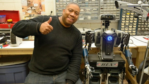 Former Baltimore cop, Mark Haygood and his robot HEX, which he made by recycling electrical equipment.